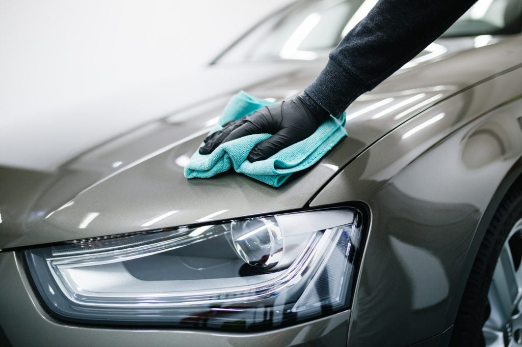 wiping a car with a microfiber towel